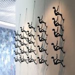Climbing Man Wall Sculpture Photo
