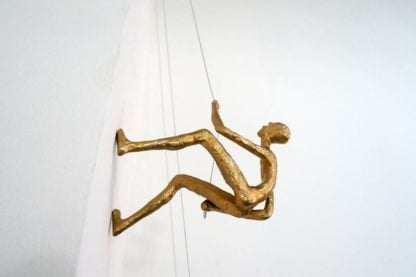 Climbing man sculpture - gold color