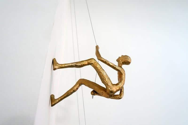 Climbing man sculpture - gold color