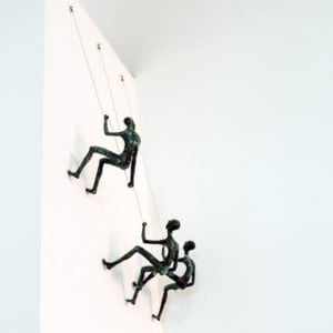 Climbing Man Wall Sculptures in Brass